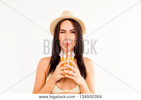 Portrait Of Pretty Tourist In Summer Hat Drinking Orange Juice