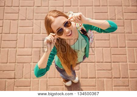 Top View Portrait Of Young Cheerful Young Girl In Spectacles