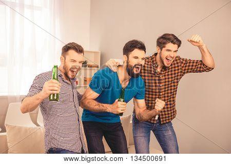 Goal!  Happy Joyful Men At Home Watching Sport Game On Tv