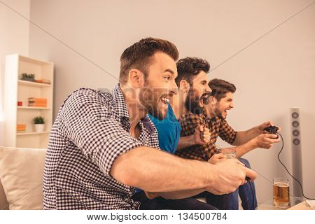 Excited Happy Cheerful Man Play Video Game With His Friends