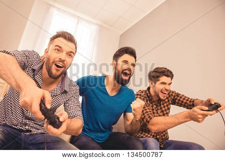 Yeah! Excited Happy Cheerful Men Play Video Game With His Friends