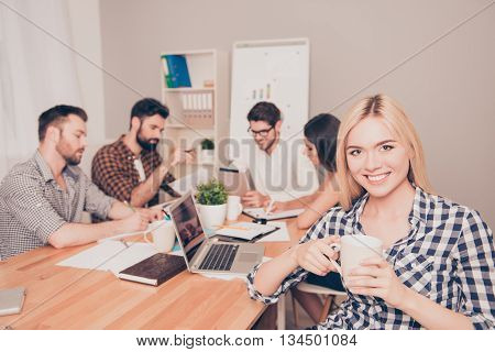 Beautiful Businesswoman Sitting At Conference And Have Break Time