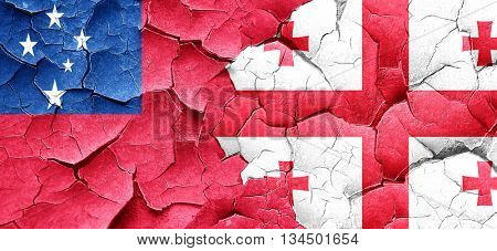 Samoa flag with Georgia flag on a grunge cracked wall