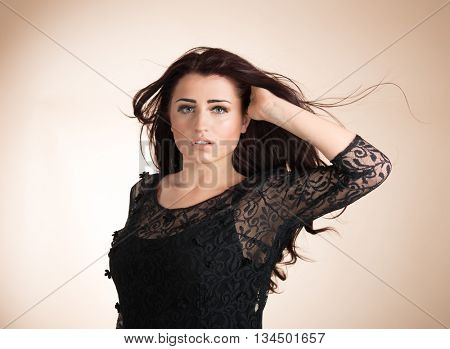 Beauty portrait of young healthy woman with hair blowing
