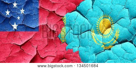 Samoa flag with Kazakhstan flag on a grunge cracked wall