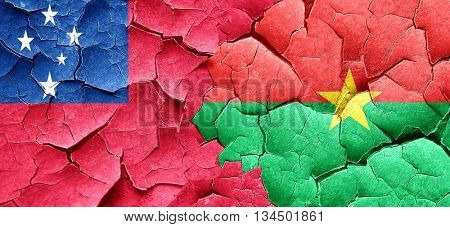 Samoa flag with Burkina Faso flag on a grunge cracked wall