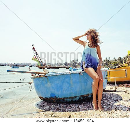 cute smiling young real woman in asian port, vietnam traveller mui ne