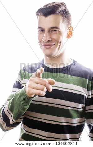 Portrait of a smart serious young man standing against white background. Emotional concept for gesture close up