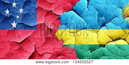 Samoa flag with rwanda flag on a grunge cracked wall