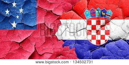 Samoa flag with Croatia flag on a grunge cracked wall