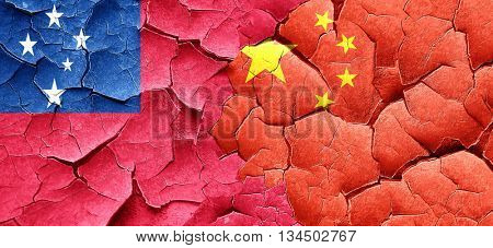 Samoa flag with China flag on a grunge cracked wall