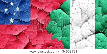 Samoa flag with Nigeria flag on a grunge cracked wall