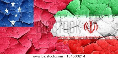Samoa flag with Iran flag on a grunge cracked wall