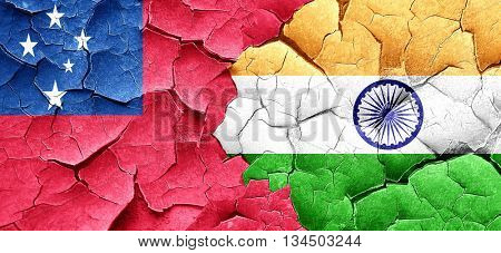 Samoa flag with India flag on a grunge cracked wall