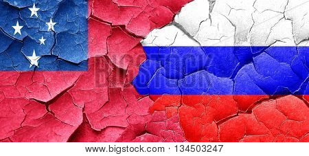 Samoa flag with Russia flag on a grunge cracked wall