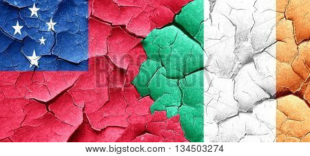 Samoa flag with Ireland flag on a grunge cracked wall