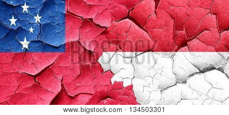 Samoa flag with Indonesia flag on a grunge cracked wall