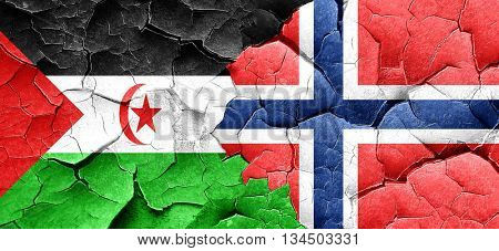 Western sahara flag with Norway flag on a grunge cracked wall