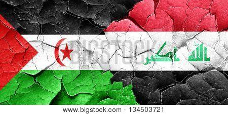 Western sahara flag with Iraq flag on a grunge cracked wall