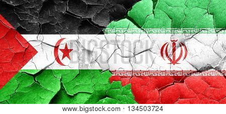 Western sahara flag with Iran flag on a grunge cracked wall