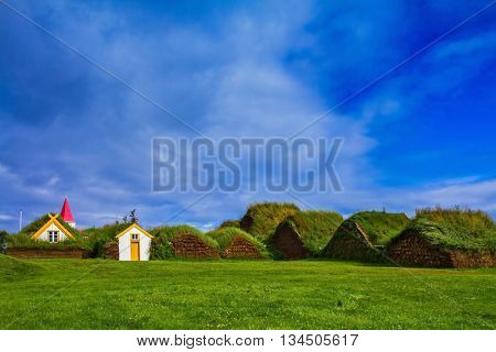 The recreated village - the museum of pioneers - Vikings. The village of ancestors in Iceland. Houses are roofed by the turf