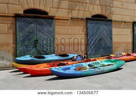 colorful kayaks outdoors on the store travel background