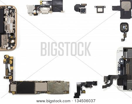 Flat lay (top view) of smart phone components isolate on white background with copy space