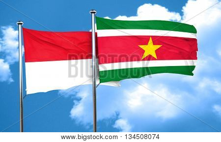 monaco flag with Suriname flag, 3D rendering