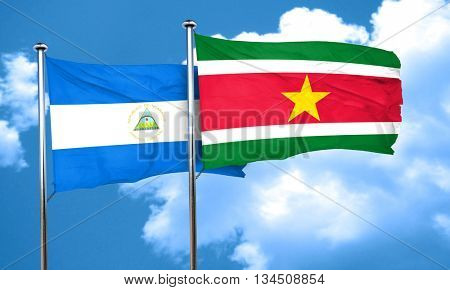nicaragua flag with Suriname flag, 3D rendering