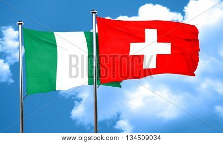 Nigeria flag with Switzerland flag, 3D rendering