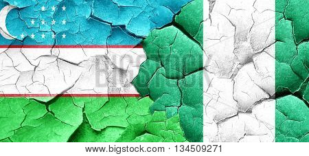 Uzbekistan flag with Nigeria flag on a grunge cracked wall