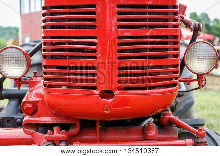 Close-up of the grille of a shiny red tractor