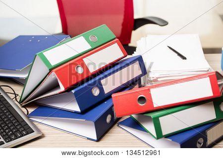 Stacks of office binders on desk