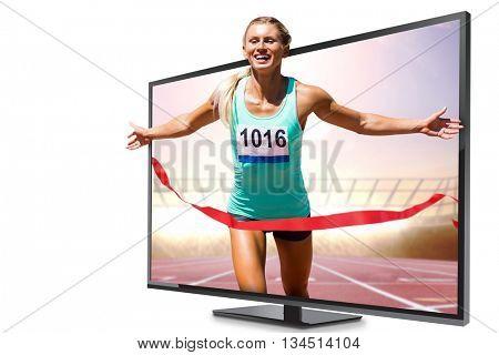 Sportswoman finishing her run against race track