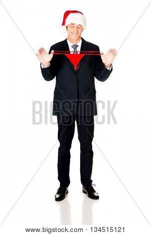 Santa businessman holding female thongs