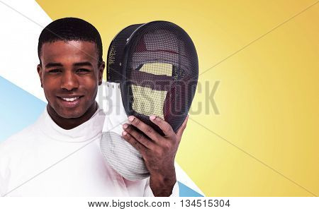 Swordsman holding fencing mask against different colors