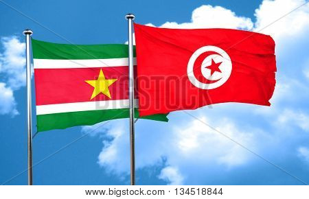 Suriname flag with Tunisia flag, 3D rendering