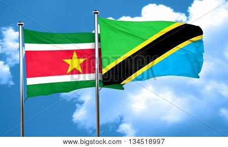 Suriname flag with Tanzania flag, 3D rendering