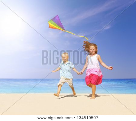 Sibling playing together on the beach.