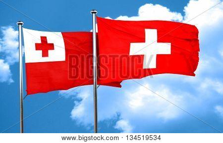 Tonga flag with Switzerland flag, 3D rendering