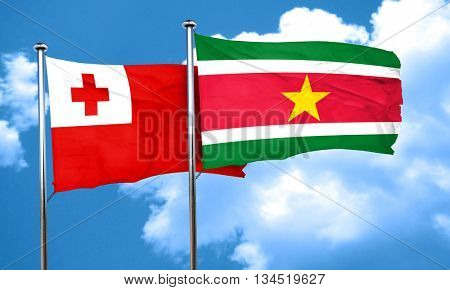 Tonga flag with Suriname flag, 3D rendering