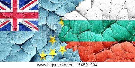 Tuvalu flag with Bulgaria flag on a grunge cracked wall