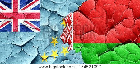 Tuvalu flag with Belarus flag on a grunge cracked wall