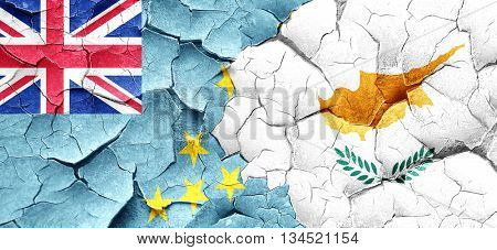 Tuvalu flag with Cyprus flag on a grunge cracked wall