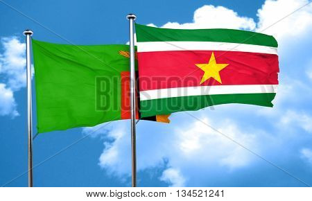 Zambia flag with Suriname flag, 3D rendering