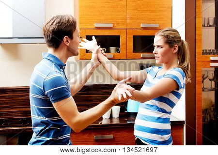 Young couple having quarrel in the kitchen