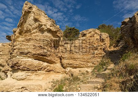 Stone ladder. Conducts on a beach cape Fiolent. Heraclean peninsula on the southwest coast of Crimea. Balaclava district of Sevastopol.