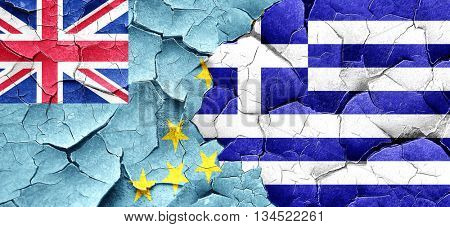 Tuvalu flag with Greece flag on a grunge cracked wall