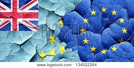 Tuvalu flag with european union flag on a grunge cracked wall