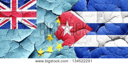 Tuvalu flag with cuba flag on a grunge cracked wall
